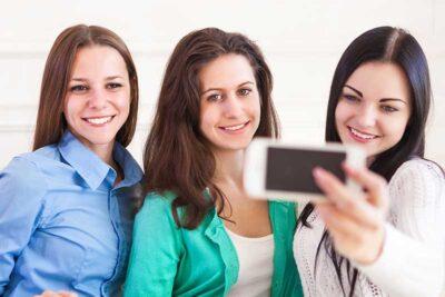Three girls with camera