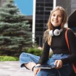 Girl with headphone and tablet