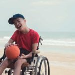 Boy in wheelchair with ball